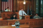 Ted Kolberg of Marquette HS addresses the chamber, 2001.