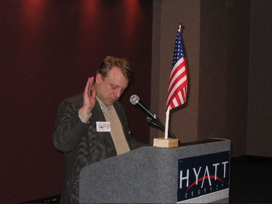 State Rep. Josh Zepnick (D-Milwaukee) administers the Oath of Office.
