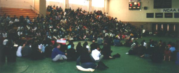 The audience continues to watch the awards assembly.